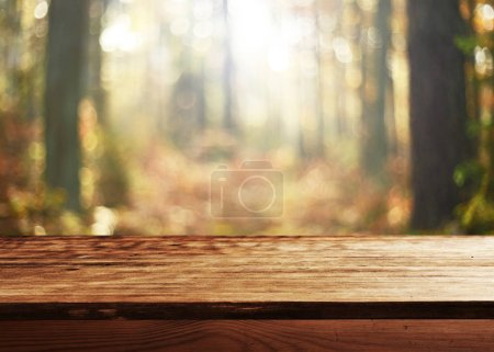 Photo for Empty table with blurred natural background - Royalty Free Image