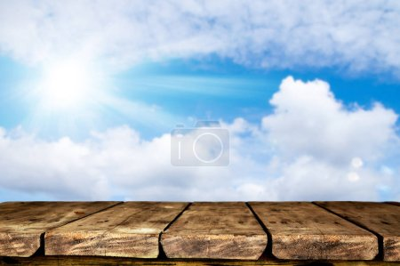Photo for Empty wooden table with blurred natural background - Royalty Free Image