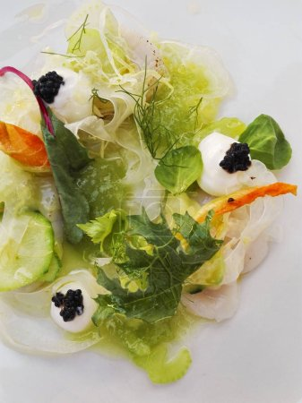 Photo for Salad with lattuce, mozzarella cheese, rosted carrots and vegetarian caviar - Royalty Free Image