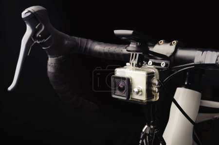 Photo for Bicycle with front action camera on black background - Royalty Free Image