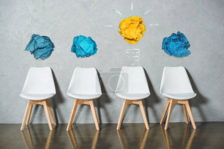 concept of idea with chairs for job interview and crumpled papers