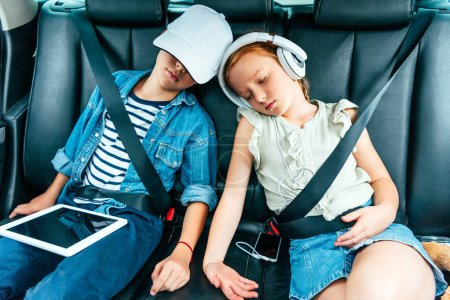exhausted children with digital devices