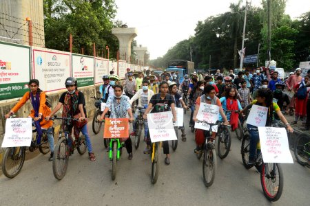 Photo for Students and activist held a cycle rally to protest against an alleged gang-rape and stripping and torturing of a woman in the district of Noakhali, in front of National Press club in Dhaka, on October 15, 2020 - Royalty Free Image