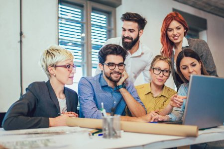Young creative coworkers discussing new project in office