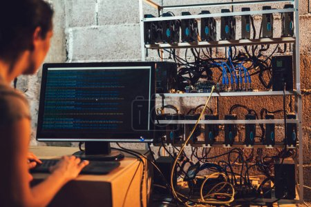 Silhouette of programmer adjusting cryptocurrency mining rig to optimal operational settings
