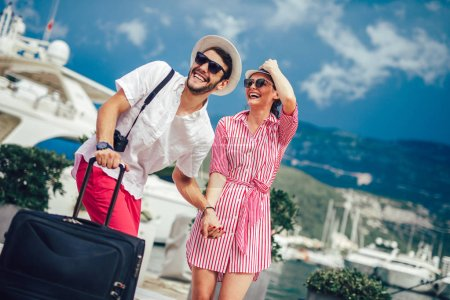 Couple of tourists sightseeing in travel destination with port