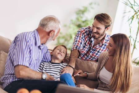 Photo for Portrait of a three generation family spending time together at home - Royalty Free Image