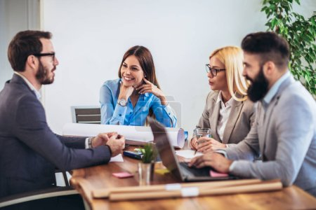 Photo for Business people working together on project and brainstorming in office - Royalty Free Image