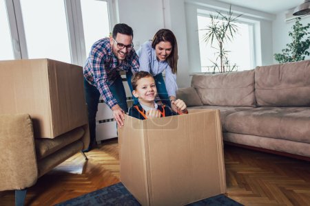 Photo for Happy family moving home with boxes around, and having fun. - Royalty Free Image
