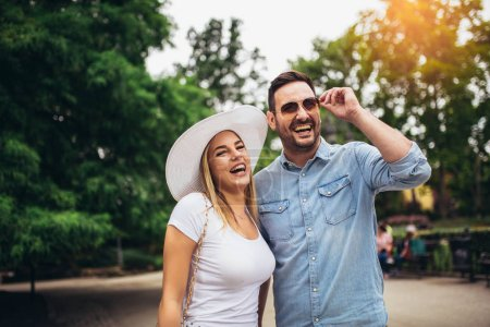 Photo for Happy young couple having fun outdoors and smiling. - Royalty Free Image
