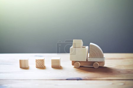 Wooden model of truck loading freight, shipping and delivery concept.