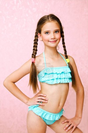 Photo for Portrait of cute smiling little girl child schoolgirl teenager in swimsuit isolated fashion concept - Royalty Free Image