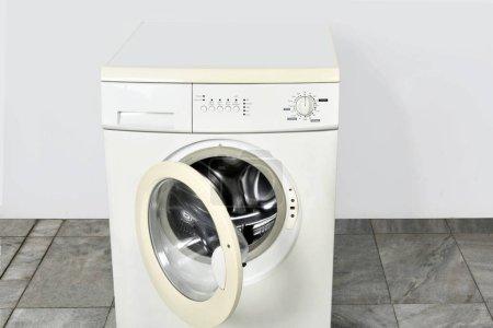 Washing machine with open door in home
