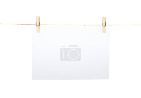 White paper sheet hanged on the rope isolated over white background