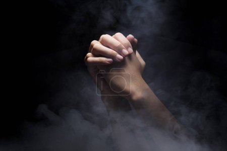 Photo for Praying hands over dark background. Christian Pray - Royalty Free Image