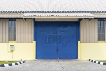 Exterior view of a warehouse building with a blue ...