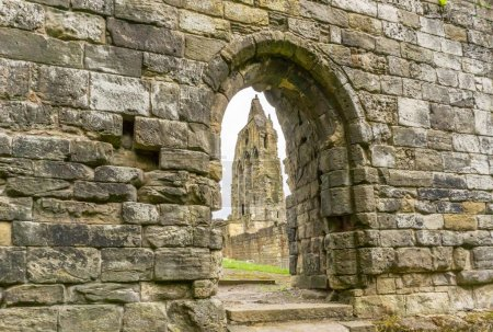 Looking through the  old stone entrance to The Old Transept Ancient Ruins Kilwinning Abbey Scotland.