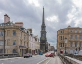 Ayr, Scotland, UK - August 05, 2018: New Bridge Street to the Old Sandgate & Ayr Town Hall in Ayr Scotland with many empty shops and business premises.