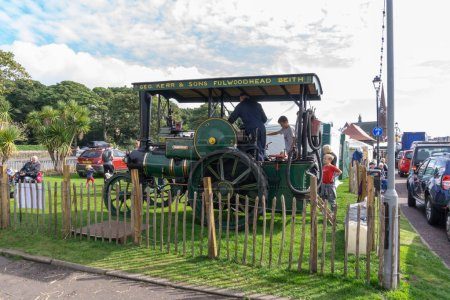 Largs, Scotland, UK - September 2018: Ancient Steam Driven Ayrshire Tractor and visitors to Largs enjoying the annual food festival held in conjunction with the Viking festival bringing much needed tourism to the Scottish town.
