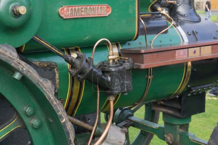 Largs, Scotland, UK - September 2018: Ancient Steam Driven Ayrshire Cameronian Tractor Piston at the annual food festival held in conjunction with the Viking festival bringing much needed tourism to the Scottish town and a good example of this ancien