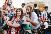 MOSCOW, RUSSIA - JUNE 2018 Cyclist traveler Matyas Amaya photographed with football fans in the center of Moscow during the World Cup 2018