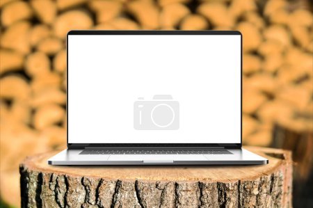 Photo for Laptop with blank screen in the forest. - Royalty Free Image