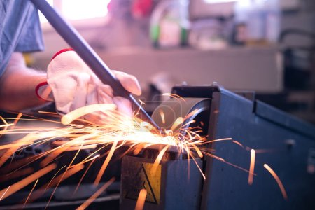 Grinding steel with lot of sparks.