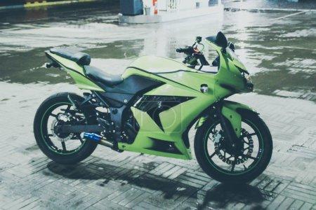 Green sport motorcycle. Nice photo of sportbike.Motorcike Ninja.Kawasaki Ninja 250R.