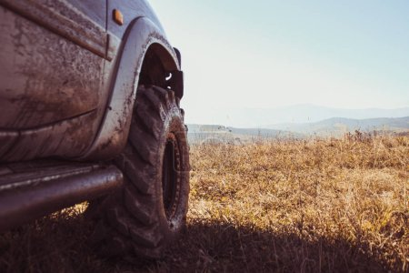 Offroad car in Carpathians. Mountains Mount Gimbia Traveling by car. Landscapes of autumn mountains.
