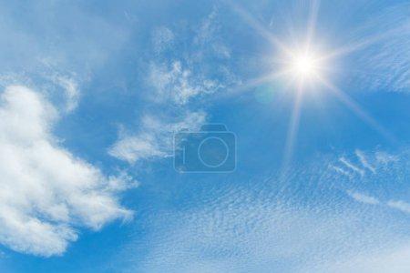 clouds blue sky and sun.