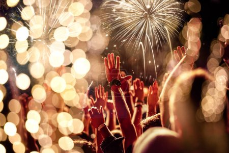 Photo for Crowd with raised hands watching fireworks - New Year concept - Royalty Free Image