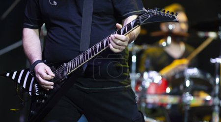Photo for Guitarist on stage during concert - Royalty Free Image