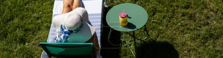 Photo for Top view of woman sunbathing in back yard summer fun - Royalty Free Image