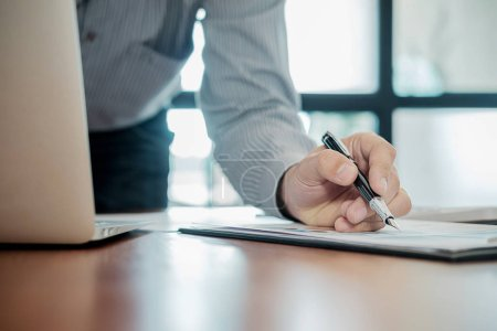 Photo for Administrator business man financial inspector and secretary making report calculating balance. Internal Revenue Service checking document. Audit concept - Royalty Free Image