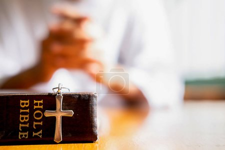 Photo for Holy bible and cross on table with Christian woman hoping for better. Asking God for good luck, Success, Forgiveness. Power of religion, Belief, Worship. - Royalty Free Image