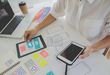 Photo for Creative Web Designer planning application and developing template layout, framework for mobile phone. User experience (UX) concept. - Royalty Free Image