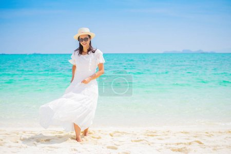 Photo for Happy woman enjoying beautiful sunset on the beach. Relaxing concept - Royalty Free Image
