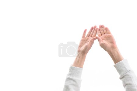 cropped view of woman with hands up, isolated on white