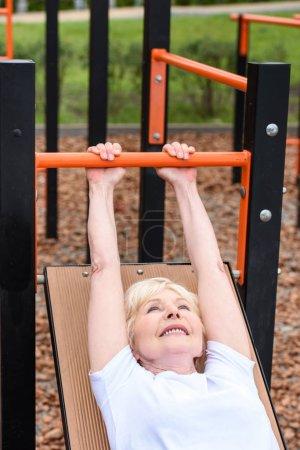 senior sportive woman training on sports ground
