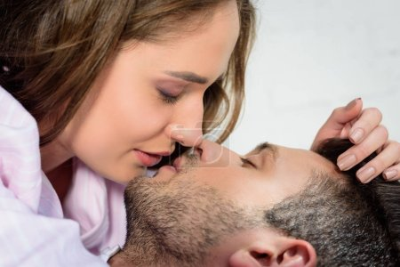 beautiful sensual young couple kissing at home