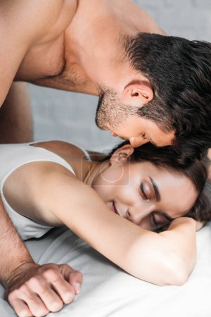 sensual couple of lovers lying on bed in morning