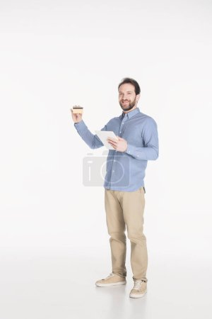 smiling man with digital tablet showing credit card isolated on white