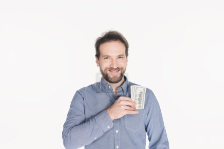 portrait of cheerful bearded man with dollar banknotes in pocket isolated on white