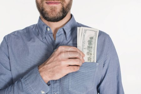 partial view of bearded man with dollar banknotes in pocket isolated on white