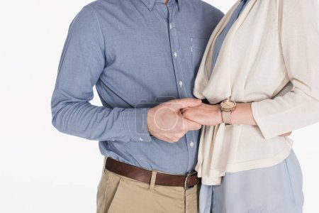 cropped shot of married couple holding hands together isolated on white