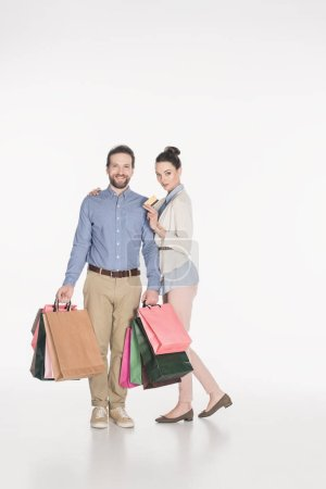 couple with shopping bags and credit card isolated on white