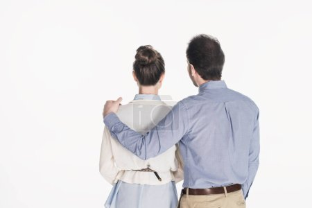 back view of man hugging wife isolated on white