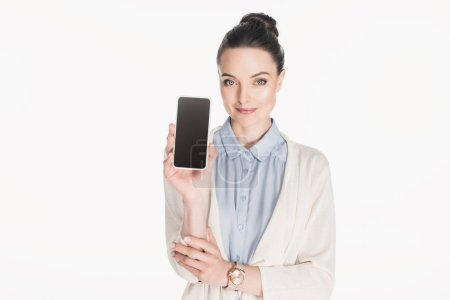 Photo for Portrait of woman showing smartphone with blank screen isolated on white - Royalty Free Image