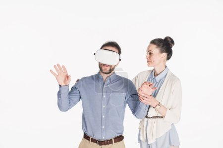 portrait of man in virtual reality headset with smiling wife near by isolated on white