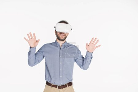 portrait of smiling man in virtual reality headset with outstretched arms isolated on white